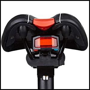 Mount the light under the saddle.